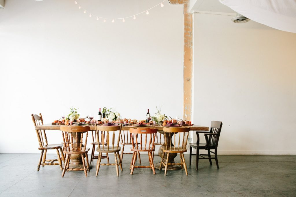 image of a table set in a room, surrounded with many chairs.